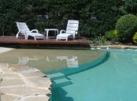 piscina irregular deck en voladizo vereda perimetral, piedras naturales playa en hormigòn coloreado ubicaciòn: el pinar sta fe